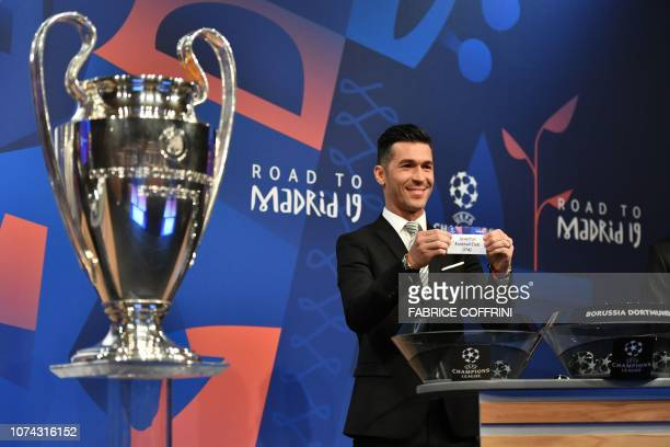 Former Portuguese football player Ricardo Carvalho shows the slip of Juventus next to the cup during the draw for the round of 16 of the UEFA...