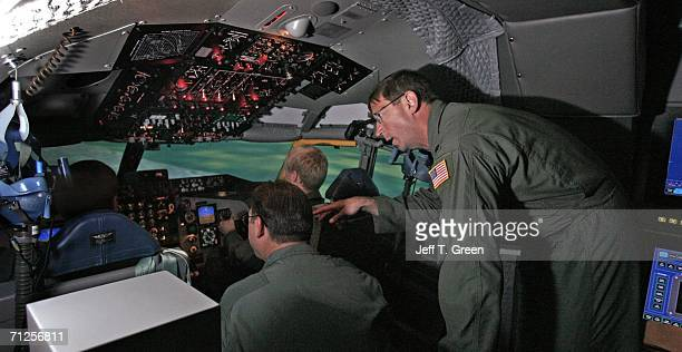 Former POW Lt Col Richard Dale Storr discusses flight tactics with other Washington Air National Guard members inside a Boeing KC135R training...
