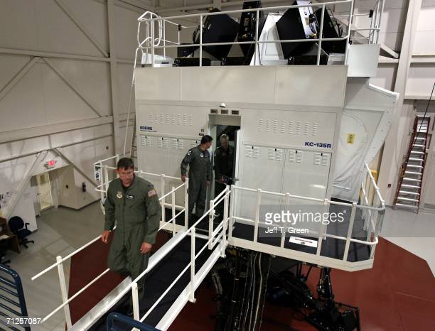 Former POW Lt Col Richard Dale Storr leaves a Boeing KC135R training simulator with Washington Air National Guardsmen Bill Reeves and 1st Lt Nathan...