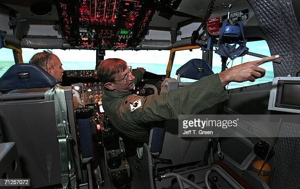Former POW Lt Col Richard Dale Storr points out the instructor control panel to his pharmacy business partner Lon Covin inside a Boeing KC135R...