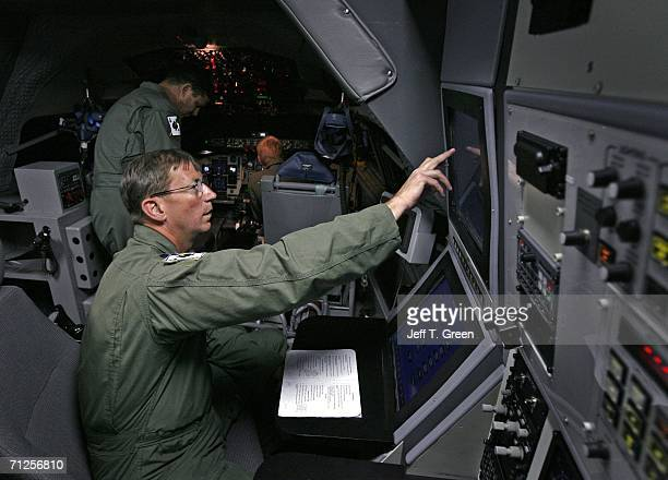 Former POW Lt Col Richard Dale Storr sets the instructor control panel inside a Boeing KC135R training simulator at Fairchild Air Force Base June 20...