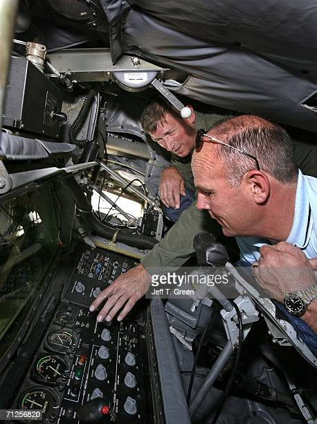 Former POW Lt Col Richard Dale Storr shows his pharmacy business partner Lon Covin the refueling control panel of a KC135R refueling tanker of the...