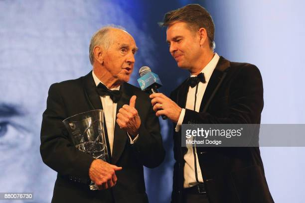 Former Premier of Victoria John Cain speaks with former tennis player Todd Woodbridge on stage at the 2017 Newcombe Medal at Crown Palladium on...