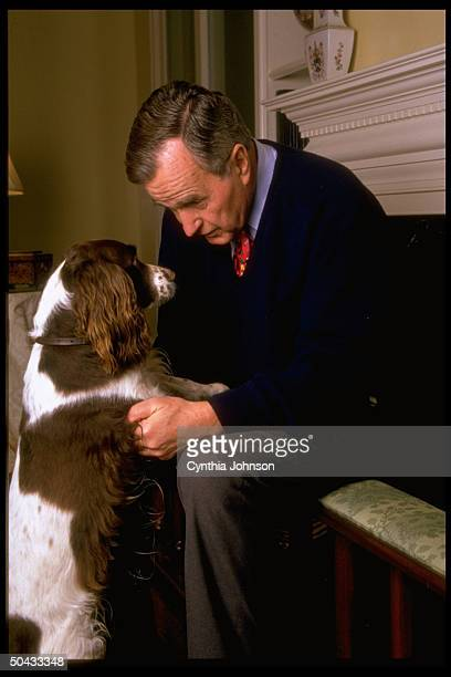 Former Pres George Bush having facetoface chat w Barbara's author/dog Millie enjoying life after presidency at home in Houston TX