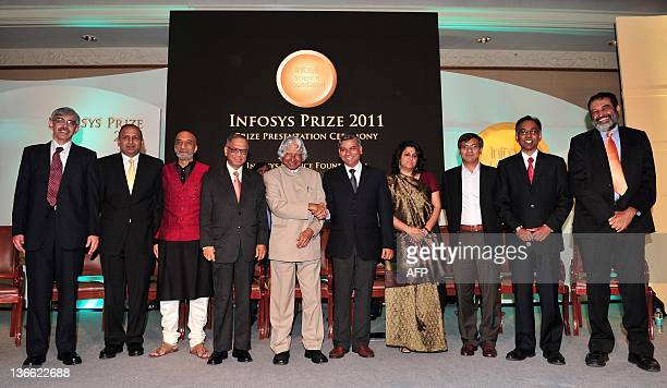 Former president Abdul Kalam greets Infosys Founder NR Narayana Murthy and the award recipients at a function held in Bangalore on Januray 9 2012 The...