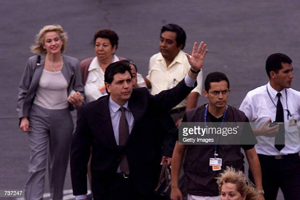 Former President Alan Garcia waves to his supporters after arriving at the Jorge Chavez airport January 28 2001 in Lima Peru Garcia the populist...