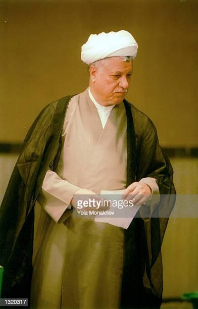 Former president Ali Akbar Hashemi Rafsanjani casts his vote in the presidential election June 8, 2001 in northern Tehran, Iran. President Mohammad...