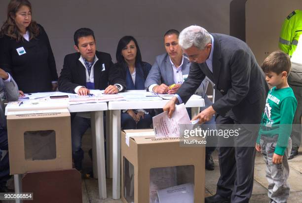 Former President Alvaro Uribe Velez casts his vote during Colombian parliamentary elections at Congress of Colombia in Bogota Colombia on March 11...