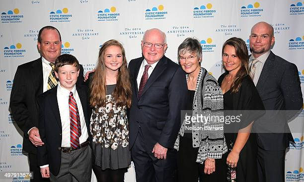 Former President and CEO of Cystic Fibrosis Foundation Dr Robert J Beall poses with wife Mimi and family at the Cystic Fibrosis Foundation's 60th...
