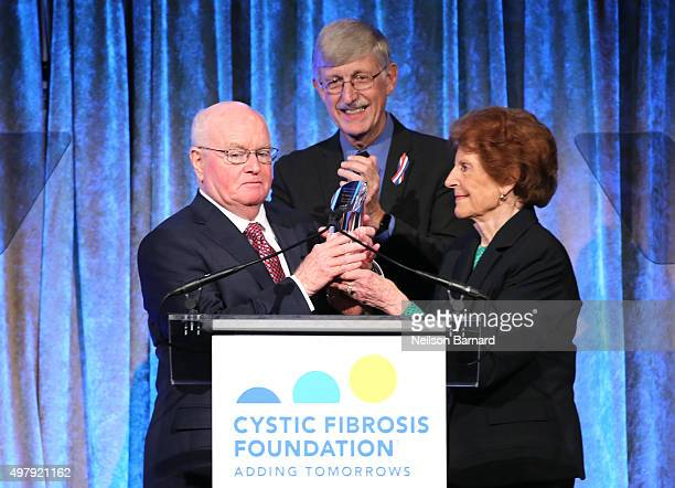 Former President and CEO of Cystic Fibrosis Foundation Dr Robert J Beall accepts the Breath of Life Award presented by Director National Institutes...