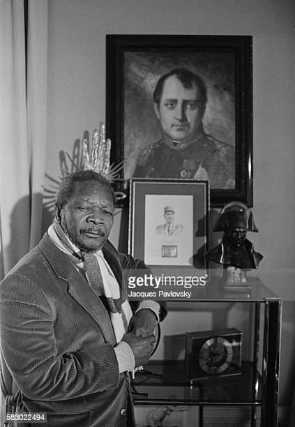 Former President and selfproclaimed Emperor of Central African Republic Jean Bedel Bokassa poses with a portrait of Napoleon I as he organizes a tour...