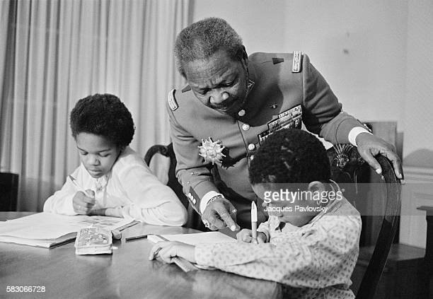 Former President and selfproclaimed Emperor of Central African Republic JeanBedel Bokassa wears his uniform of Marechal with his sons as he organizes...