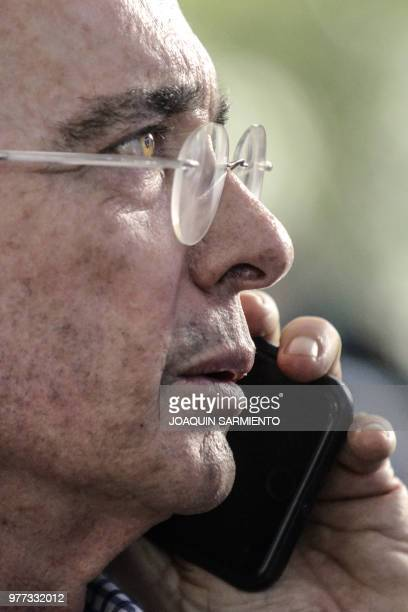 Former president and senator Alvaro Uribe talks on the phone after Ivan Duque from his Democratic Center Party won the presidency in the runoff...
