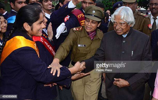 Former President APJ Abdul Kalam talks with the students during a science exhibition in Allahabad