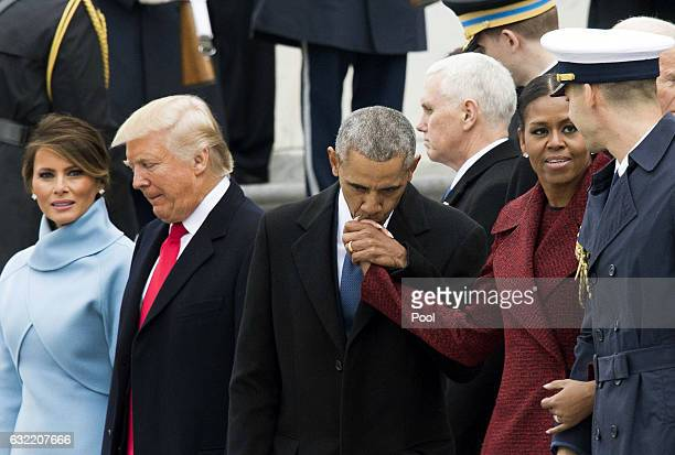 Former President Barack Obama and former First Lady Michelle Obama hug Vice President Joe Biden and his wife Jill Biden following the inauguration of...