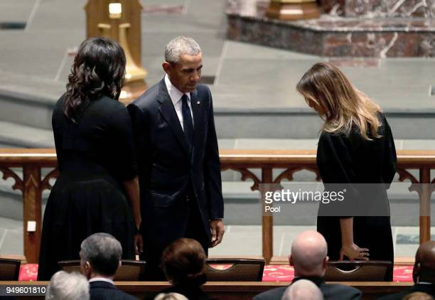 Former President Barack Obama and former first lady Michelle Obama greet first lady Melania Trump at St Martin's Episcopal Church for a funeral...
