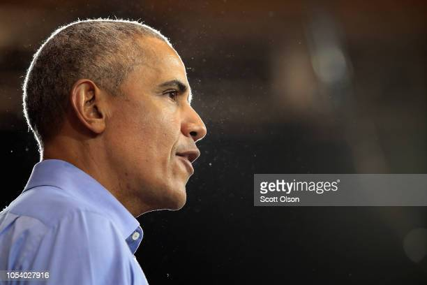 Former President Barack Obama campaigns for Wisconsin Democratic candidates during a rally at North Division High School on October 26 2018 in...