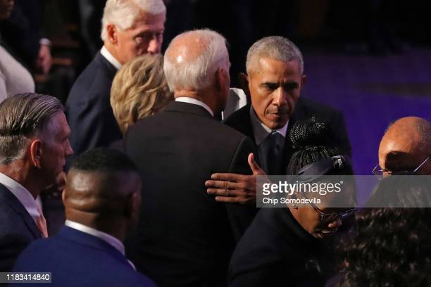 Former President Barack Obama embraces former Vice President Joe Biden at the conclusion of the funeral service for Rep Elijah Cummings at New...