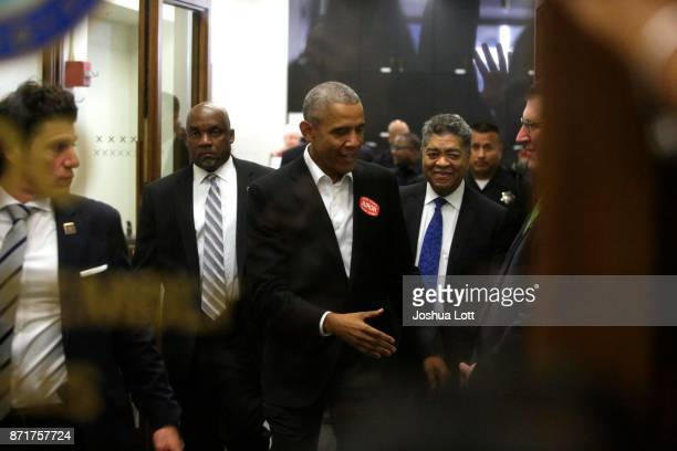Former President Barack Obama extends his hand as he attends Cook County jury duty at the Daley Center on November 8 2017 in Chicago Illinois Jurors...