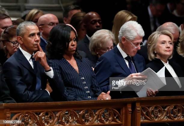 Former President Barack Obama former first lady Michelle Obama former President Bill Clinton and former Secretary of State Hillary Clinton listen as...