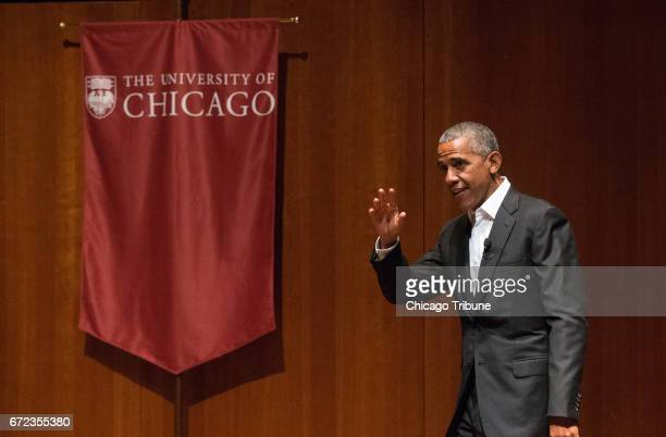 Former President Barack Obama gestures at a discussion with six Chicago-area students on Monday, April 24, 2017 at the Logan Center for the Arts on...