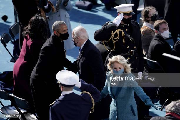 Former president Barack Obama greets President Joe Biden after the 59th Presidential Inauguration on January 20, 2021 in Washington, DC. During...