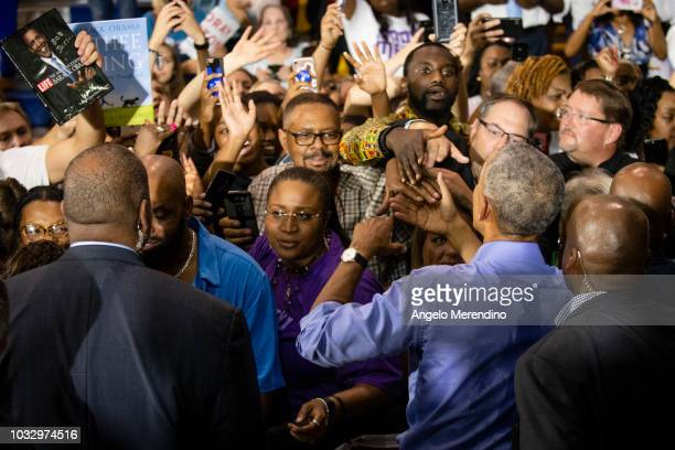 Former President Barack Obama shakes hands with supporters during a campaign rally for Ohio Gubernatorial candidate Richard Cordray at CMSD East...