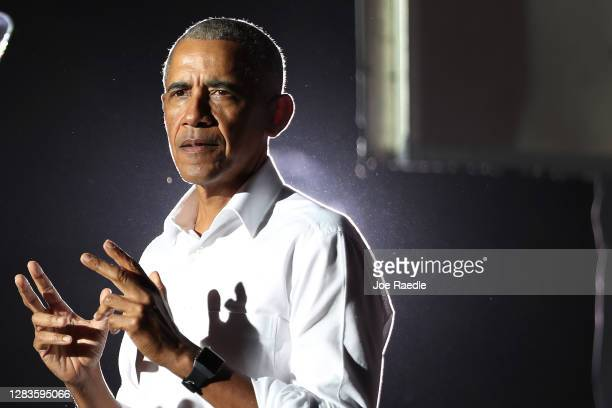 Former President Barack Obama speaks in support of Democratic presidential nominee Joe Biden during a drive-in rally at the Florida International...