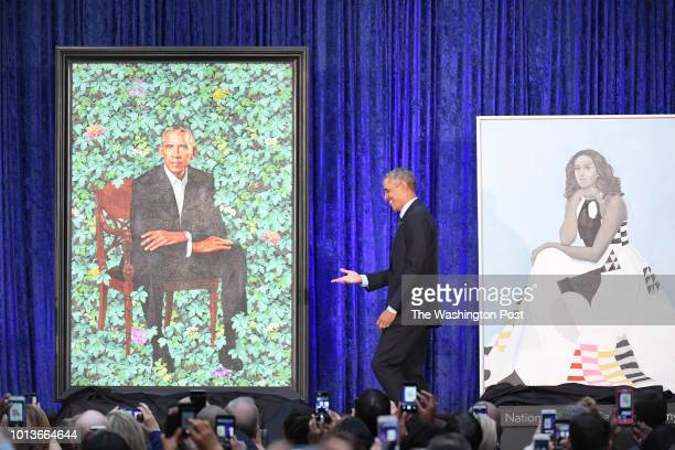 Former President Barack Obama stands next to presidential portrait as he and former First Lady Michelle Obama have their portraits unveiled at the...