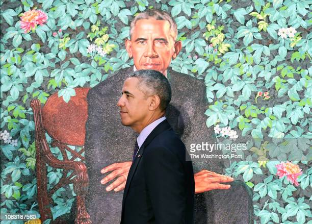 Former President Barack Obama walks by his presidential portrait as he and former First Lady Michelle Obama have their portraits unveiled at the...