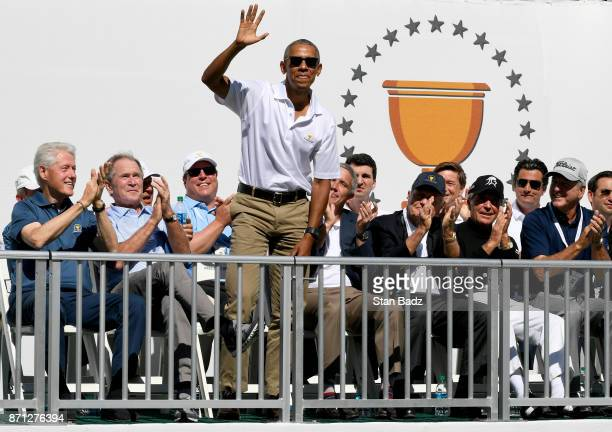 Former President Barack Obama waves during the trophy presentation on the first tee as former Presidents Bill Clinton and George W Bush look on...