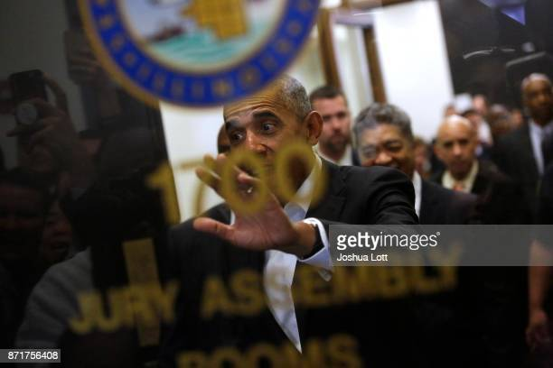 Former President Barack Obama waves to a crowd of people as he attends Cook County jury duty at the Daley Center on November 8 2017 in Chicago...