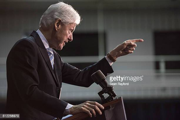 Former President Bill Clinton addresses the audience at Freedom Temple Ministry while campaigning for his wife Democratic presidential candidate...