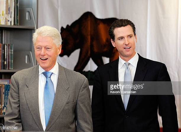 Former President Bill Clinton and California gubernatorial candidate San Francisco Mayor Gavin Newsom are introduced during a discussion with...