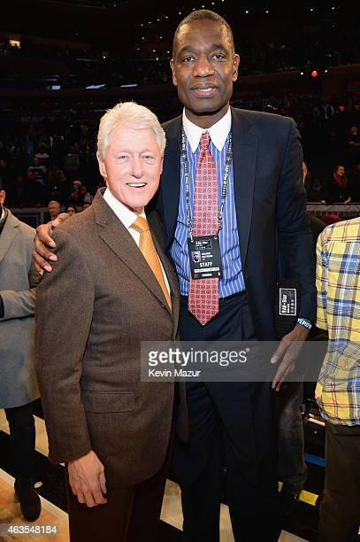 Former president Bill Clinton and Dikembe Mutombo attend The 64th NBA AllStar Game 2015 on February 15 2015 in New York City