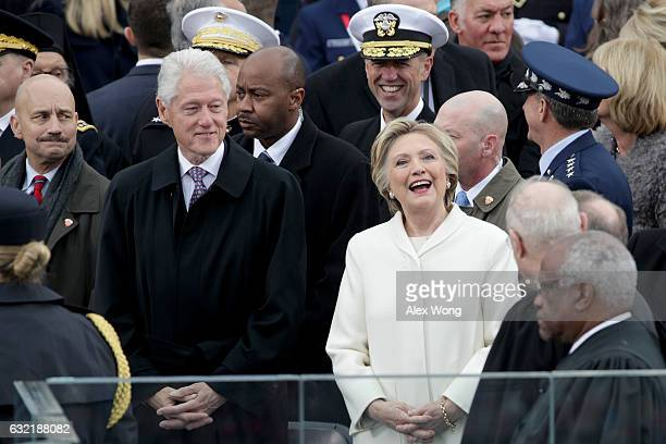 Former President Bill Clinton and former Democratic presidential nominee Hillary Clinton arrive on the West Front of the US Capitol on January 20...