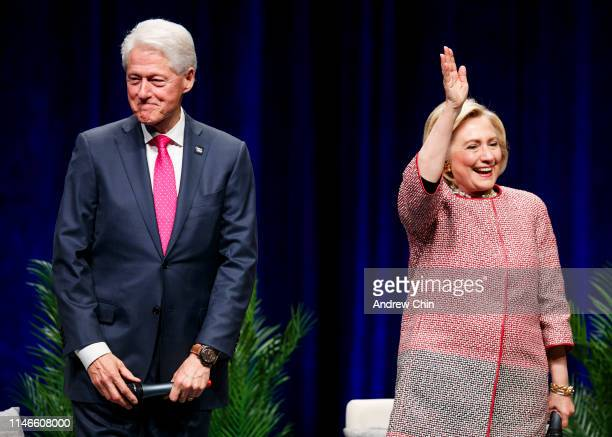 """Former President Bill Clinton and former Secretary of State and presidential candidate Hillary Clinton on stage during """"An Evening with President..."""