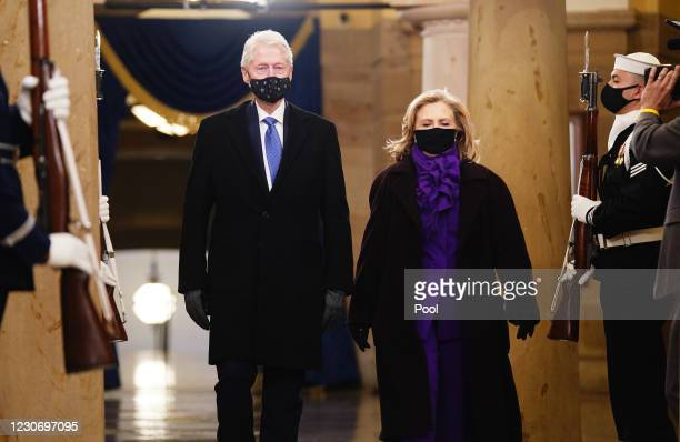 Former President Bill Clinton and former Secretary of State Hillary Clinton arrive in the Crypt of the US Capitol for President-elect Joe Biden's...