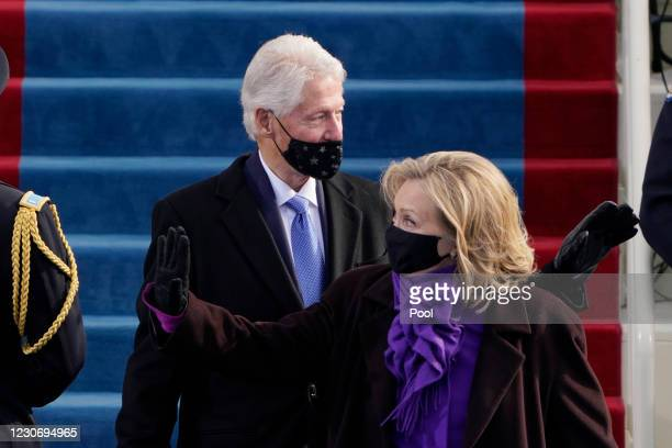 Former President Bill Clinton and his wife former Secretary of State Hillary Clinton arrive for the 59th inaugural ceremony on the West Front of the...
