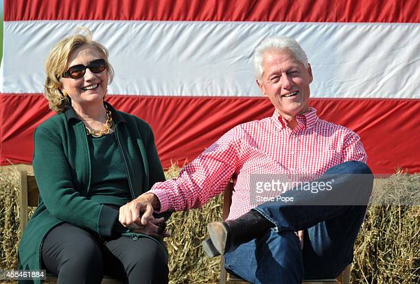 Former President Bill Clinton and his wife former Secretary of State Hillary Rodham Clinton attend the 37th Harkin Steak Fry September 14 2014 in...