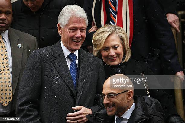 Former president Bill Clinton and his wife former Secretary of State Hillary Clinton leave St Ignatius Loyola Church after the funeral of former...