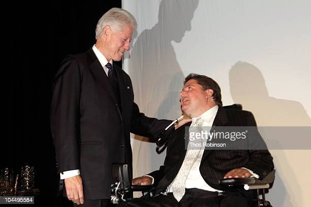 Former President Bill Clinton and Marc Buoniconti speak during the 25th Great Sports Legends Dinner to benefit The Buoniconti Fund to Cure Paralysis...