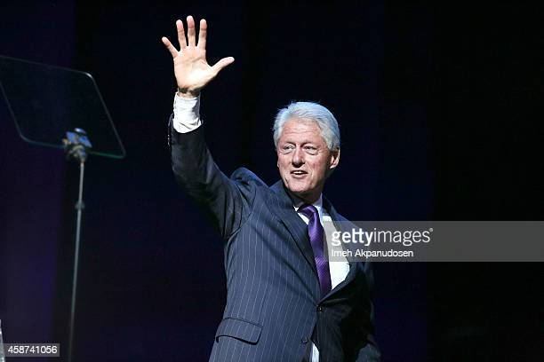 Former President Bill Clinton appears onstage at the 2014 Thelonious Monk International Jazz Trumpet Competition at Dolby Theatre on November 9 2014...