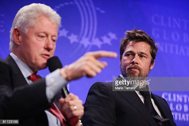 Former President Bill Clinton appears with actor Brad Pitt while discussing postKatrina New Orleans at the Clinton Global Initiative September 24...