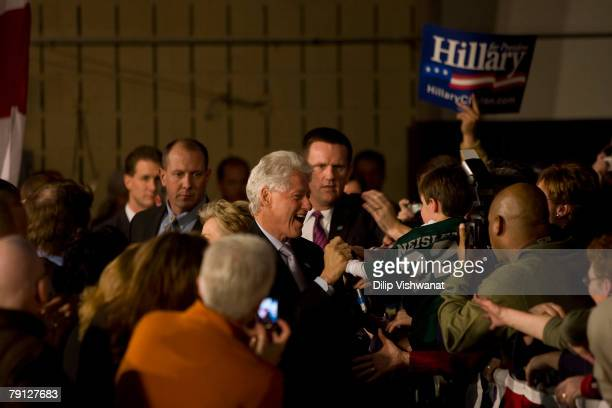 Former President Bill Clinton arrives at a town hall meeting with his wife Democratic presidential hopeful Sen Hillary Clinton following the Nevada...