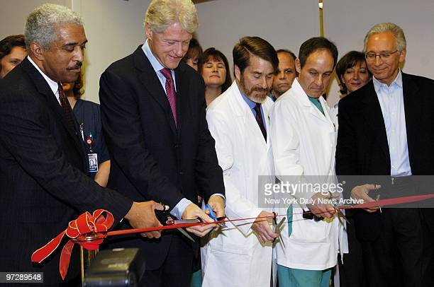 Former President Bill Clinton cuts the ribbon during ceremony to open the new catheterization center at the Westchester Medical Center in Valhalla NY...