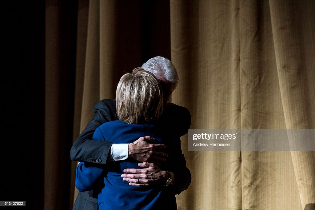 Former President Bill Clinton embraces his wife, Democratic presidential candidate Hillary Clinton, during a fundraiser at Radio City Music Hall on March 2, 2016 in New York City. Clinton won seven states in yesterday's Super Tuesday.