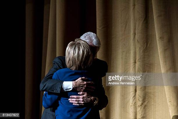 Former President Bill Clinton embraces his wife Democratic presidential candidate Hillary Clinton during a fundraiser at Radio City Music Hall on...