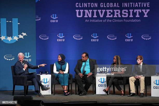 Former President Bill Clinton far left speaks at the opening session of the Clinton Global Initiative held at Northeastern University in Boston on...