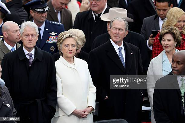 Former President Bill Clinton former Democratic presidential nominee Hillary Clinton former President George W Bush and Laura Bush stand on the West...